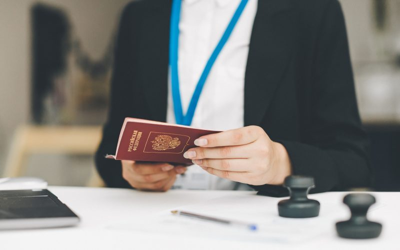 visa officer puts a stamp in the passport